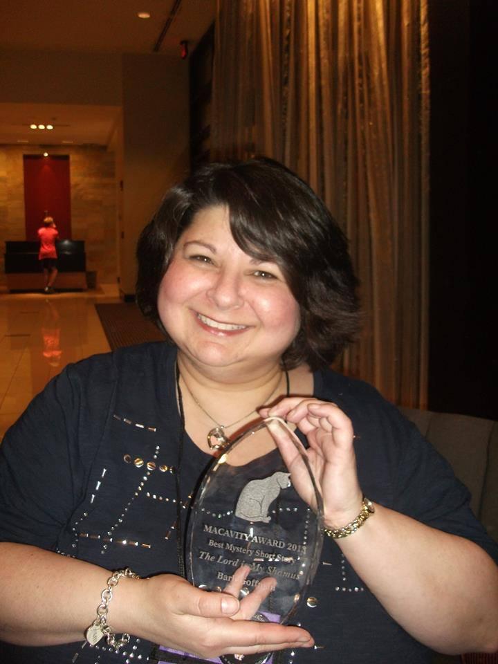 Barb Goffman with her Macavity Award